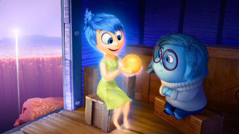 Joy (voice of Amy Poehler) and Sadness (voice of Phyllis Smith) catch a ride on the Train of Thought in Disney?Pixar's